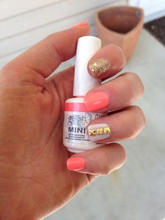 Coral and gold with gold studs accent nail
