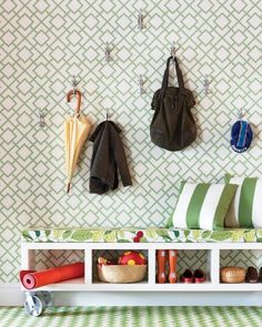 Make the most of your entryway with a storage bench and staggered wall hooks.