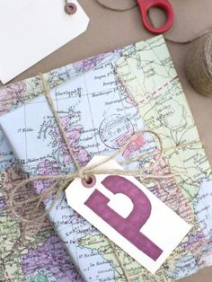 Maps & jute twine with a simply card made from a shipping tag (available at all office supply stores). BellaRusticaDesign.com