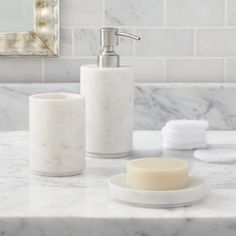 Shop Set of 3 Graydon Accessories.  Cool, classic marble beautifies the bath in modern, straight-line shapes.  Made of a natural material, each piece will vary slightly in tone and markings.