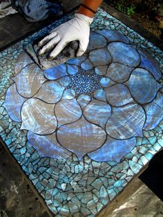 grouting mosaics Here you can the mosaic in the grouting process - my favorite part! Kasia Mosaics - Stained Glass Mosaic Art, Process and Education by Kasia Polkowska ~ Alamosa, Colorado Add Character to Your Garden by Turning Broken China into Gorgeous Mosaic Crafts, Mosaic Projects, Stained Glass Projects, Stained Glass Art, Mosaic Glass Art, Diy Projects, Mosaic Designs, Mosaic Patterns, Mosaic Madness