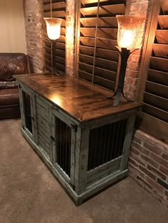 Urban farmhouse design with birdsong blue distressed paint finish.  Medium indoor double Dog kennel.  All double kennels come standard with a center interior door that latched back to provide one open space or can latch into place and become two separate spaces.  We can add a vintage look with reclaimed lumber, or industrial design, wrapped in steel.  Great entertainment center, entry table.  Replace your wire crate.