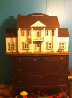 100 year old dresser and daughters old doll house in granddaughters bedroom