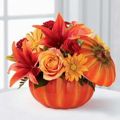 A pumpkin! How original for a centerpiece! This is so different from the cornucopia, and the traditional centerpieces. Would be fantastic for any gathering, to stand alone or with the others! And the best part? The pumpkin will be a keepsake to pull out for years to come! Would be great for a holiday gathering, or a wedding! H&J Florist and Greenhouses of St Joseph MI 269-429-3621