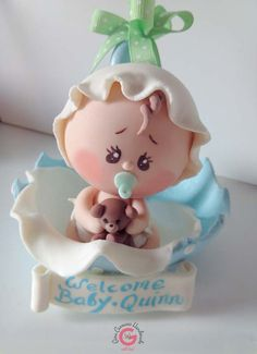 Baby Shower, Baby in Umbrella Cake Topper!  Your family and friends will think its made of Sugar, but its even better than that, it is made of 100% non toxic Cold Porcelain Paste! It can go from decorating your cake right into the babys nursery to be kept as a keepsake. Cold