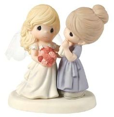 """Where does the time go? She was once her mother's tiny bundle of joy, and now she stands before her as a breathtaking bride. This figurine of a mother gazing lovingly at her daughter, with tears of joy in her eyes, makes a thoughtful wedding gift or a special present for the mother-of-the-bride. Porcelain. 5 1/4"""" H."""