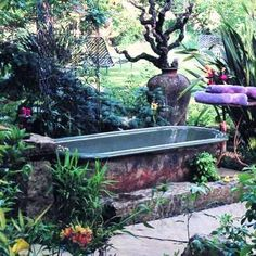 Dreamy bathtub in Anne-Marie and Jeff Allen's garden-From Sunset Magazine and more tub in garden ideas