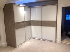 Fitted corner sliding wardrobe is a great way to maximise your storage! Pure white & stunning French grey walnut. Below is a link to our online calculator to see how much your bespoke made to measure wardrobe will cost http://www.foxwardrobes.co.uk/instant-online-estimator/