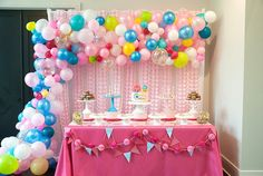 Amazing cakescape with loads of balloons surrounding from a Modern Shopkins Birthday Party at Kara's Party Ideas. See it all at karaspartyideas.com!