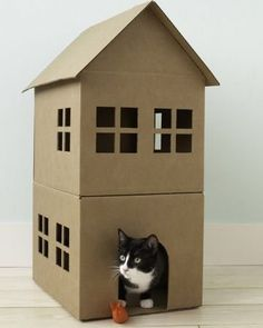 How to Make a Cardboard Cat Playhouse. How to Make a Cardboard Cat Playhouse at home article. Cat playhouse for your home. Cardboard Cat House, Diy Cardboard, Cardboard Playhouse, Cardboard Furniture, Animal Projects, Craft Projects, Recycling Projects, Project Ideas, Diy Jouet Pour Chat