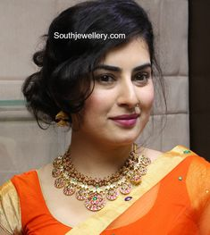 Archana in a traditional gold necklace