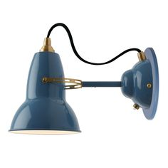 The Original 1227 Brass Wall Light features authentic Brass details with a glossy Deep Slate, Elephant Grey, or Dusty Blue finish. This fixture features a discrete switch on the canopy and a flexible shade so the light can be focused where needed. One 13 watt max 120 volt medium base bulb is required, but not included. 5.7 inch width x 5.9 inch shade height x 11.8 inch depth. Canopy: 3.9 inch width.