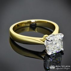 """Simply elegant, this beautiful """" Legato Sleek Line"""" Solitaire Engagement Ring is set in 18k Yellow Gold with a White Gold 4 prong head. It holds a gorgeous 1.35ct Asscher cut diamond."""