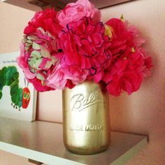 Paint a mason jar gold for an additional touch to a pink and gold nursery!