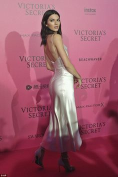 Bottoms up! Making sure all eyes were on her, the E! reality star's dress featured a saucy cowl neckline and daring thigh-high slit, which paraded her honed pins and pert behind to perfection