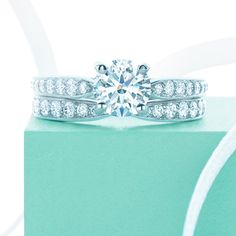 Tiffany's Harmony engagement ring with a round brilliant-cut diamond set on a tapered platinum band and matching wedding band // The Wedding Scoop's 8 Favourite Tiffany Engagement Rings Tiffany Engagement, Engagement Rings, Engagement Photos, Color Azul Tiffany, Tiffany & Co., Wedding Matches, Tiffany Jewelry, Fancy, Ring Verlobung