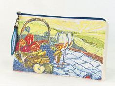 A pretty tapestry of a romantic summer picnic in the park was created with my commercial embroidery machine. Stitched on sturdy natural cotton canvas, this zip