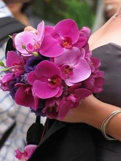 phaleonopsis orchids wedding flower bouquet, bridal bouquet, wedding flowers, add pic source on comment and we will update it. www.myfloweraffair.com can create this beautiful wedding flower look.