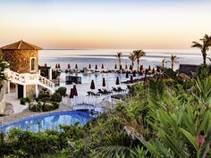 Book the Radisson Blu Milatos Beach Resort, located on Crete's northern shore & a picturesque, luxury getaway with dramatic views of the dazzling waterfront. Mykonos, Crete Holiday, Radisson Hotel, Hotels, Luxury Holidays, Beach Resorts, Mansions, House Styles, Pictures