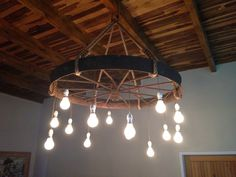 I made my own chandelier using a 50 year old wagon wheel!