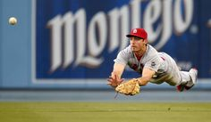 Laying out -        St. Louis Cardinals right fielder Randal Grichuk dives for but cannot get to a ball hit for a single by Los Angeles Dodgers' Enrique Hernandez on June 6 in Los Angeles.  -    © Mark J. Terrill/AP