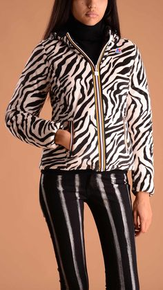 K-way Black and white thermoplus double face jacket feauturing one side in close-cropped eco fur animal printed. Zebra stripes!