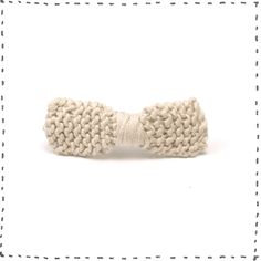 Pinch style hair clip with a hand knitted bow made from cotton.