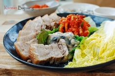 Bossam (보쌈) is a boiled pork dish. The meat is boiled in a flavorful brine until tender and served thinly sliced. At the table, each person wraps the meat in salted napa cabbage leavesalong with radish salad (musaengchae/muchae) and salted shrimp. Salted napa cabbage is traditional, but you can also use lettuce and/or perilla leaves …
