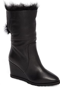 Taryn Rose Women's Shoes in Black Leather Color. Plush genuine shearling elevates the cozy appeal of an Italian-crafted boot grounded by a covered wedge.