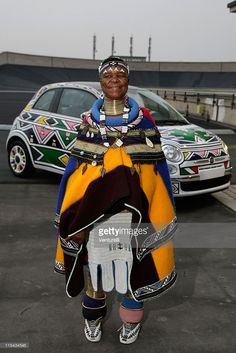 Esther Mahlangu poses with one of her exhibit pieces, a Fiat at the 'Why Africa?' exhibition opening At the Pinacoteca Giovanni E Marella Agnelli (Lingotto) on October 2007 in Turin, Italy. African Girl, African Wear, African Style, Africa Silhouette, Tribes Of The World, Latest African Fashion Dresses, Iconic Women, Car Girls, World Cultures