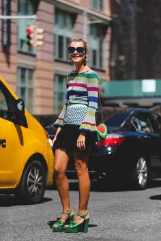 The stripes! The watermelon bag! The platforms! It's all too good to comprehend. #refinery29 http://www.refinery29.com/2016/09/120553/nyfw-spring-2017-best-street-style-outfits#slide-86