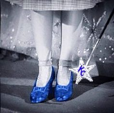 Dorothy clicks her heels three times for a KC Royals win during the 2015 World Series