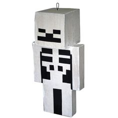 This Skeleton pinata will make the perfect gift, center piece, or party game for your next Minecraft Party. These are traditional smash with a stick pinatas.  My method of pinata making does not include the use of staples.  Every pinata is Hand-Crafted and will have slight variations.  Dimensions: 29 inches tall 14 inches wide