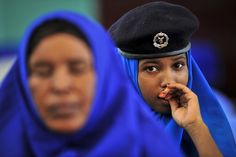 Women officers of the Somali national police are shown during a ceremony to inaugurate their training programme, conducted by the African Union Mission in Somalia (AMISOM)'s Police Training and Development Unit with funding from the Italian Government. They are among 160 officers participating in the two-week course, held at the General Kaahiye Police Academy in Mogadishu. 15 October 2012. Mogadishu, Somalia    UN Photo/Tobin Jones…