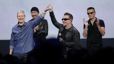 Tim Cook and U2 during a product announcement--secrets of the new album