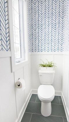 Lake house powder room featuring Serena and Lily feather wallpaper in blue. Slate tile and a crisp white and blue color scheme give a coastal vibe. wallpaper bathroom Lake House Powder Room - The Lilypad Cottage Bad Inspiration, Bathroom Inspiration, Bathroom Ideas, Bathroom Trends, Bathroom Organization, Bathroom Storage, Serena And Lily Wallpaper, Blue And White Wallpaper, Powder Room Wallpaper