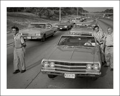 A couple of Chevrolet's lead the traffic congestion on the Eisenhower Highway, Chicago, when the road buckles in the summer heat of June, 1966.