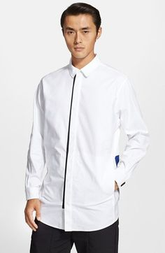 Free shipping and returns on Alexander Wang Trim Fit Sweater Back Oxford Shirt at Nordstrom.com. The staid oxford shirt gets a modern remix with a pop of black trim accenting the placket and a color-blocked knit panel finishing the lower back.