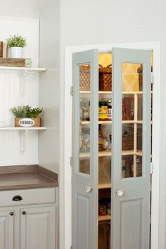 Photo: Christiaan Blok | thisoldhouse.com | from A Bright and Airy Kitchen for 343 Add a pantry to the corner of the kitchen and eliminate the need for a lot of cabinet space Frosted Glass Pantry Door, Bi Fold Pantry Doors, Pantry Door Organizer, Spice Rack On Pantry Door, Door Mounted Spice Rack, Pantry Organization, Kitchen Pantry Doors, Pantry Cupboard, Corner Pantry