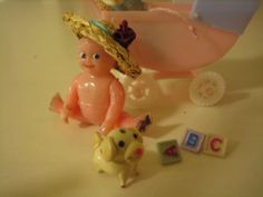 vintage plastic renwal doll. doll house miniature hat glass dog carriage