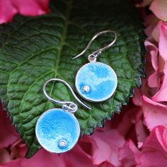 Silver earring with blue transparent enamel and af zirconia stone.