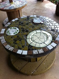 Another of my cable reel tables. Completed in 2003, this features old plates broken up and reassembled and old cutlery used as part of the design.