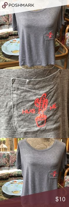 AEO WOMEN'S SOFT & SEXY TEE GRAY LARGE AMERICAN EAGLE OUTFITTERS WOMEN'S GRAY SOFT & SEXY TEE SIZE LARGE.  CUTE SHORT SLEEVE SHIRT WITH EMBROIDERED CACTUS ON POCKET AND SAYS HUG ME.  GOOD CONDITION!  PLEASE ASK FOR MEASUREMENTS BEFORE BUYING THANK YOU! American Eagle Outfitters Tops Tees - Short Sleeve