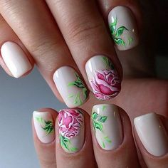 An amazing looking rose nail art design. The roses are painted on top of the nails and look as if they are ready to each outside of the nails and become a reality. A quirky yet beautiful designs with roses.