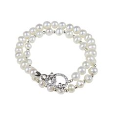 This bracelet is a double stack of organically cultured freshwater pearls with natural lustre and shine. The top stack features a Swarovski crystal inlaid charm with sterling silver flowers, and the bottom chain has alternating pearls with sterling silver beads.  Pearls: 7mm