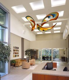 Hanging mobile art created by Banner Art Studio for Givaudan Flavors, Cincinnati, OH. Kinetic mobile art moves with indoor air currents, backlit by skylight, complements high vaulted ceilings and modern architecture.