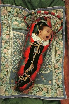 vintagenatgeographic:  Native American baby in a cradle board at the annual powwow in White Swan, Washington National Geographic | June 1994