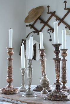 Lots of different size candlesticks. Find old, cheap ones that are all different. Silver candlestick collection