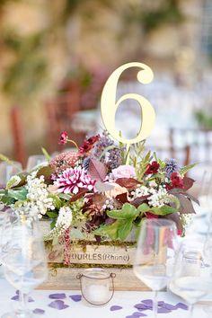 Rustic flowers for this centerpiece: http://www.stylemepretty.com/little-black-book-blog/2014/12/12/elegant-summer-tuscan-wedding/ | Photography: Emm & Clau - http://emmandclau.com/