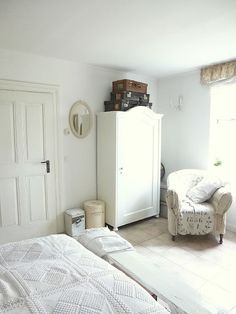 white wardrobe, grain sack chair